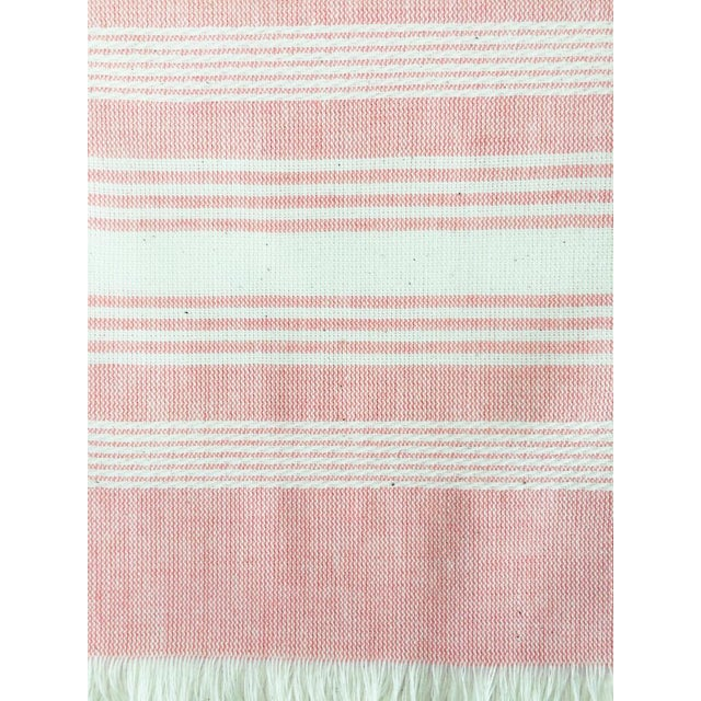 """Pink and white chambray kitchen towel, handwoven by artisans in Guatemala. 100% Cotton 24""""x31"""""""