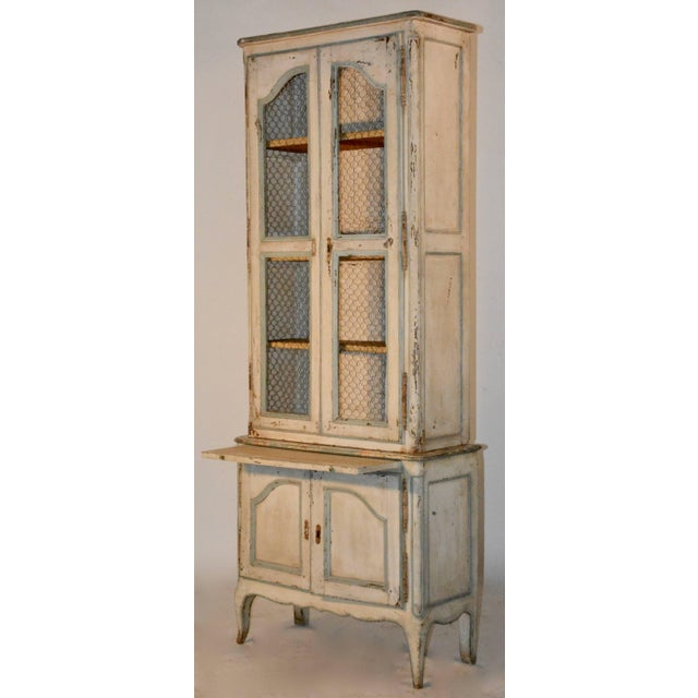 This two piece cupboard features the original paint and wire front. Has a pull-out board. Original lock mechanisms and...