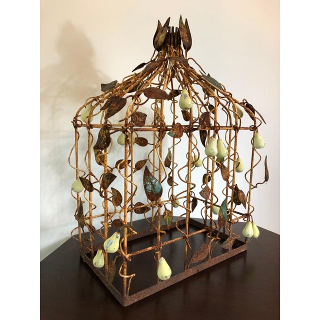 An early 20th century metal birdcage decorated with tole pears and leafs. Beautiful patina to metal and great indoor or...