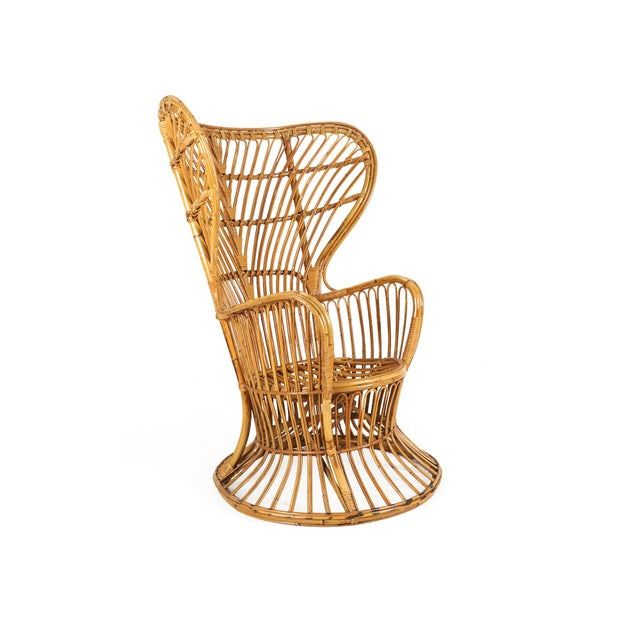 Gorgeous mid-century modern rattan peacock chair in the style of Franco Albini. Made in Italy. Very sturdy and solid.