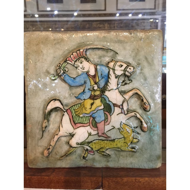Vintage or antique 19th or early 20th century Persian ceramics c tile.it is decorated with a man on the horse in Persian...