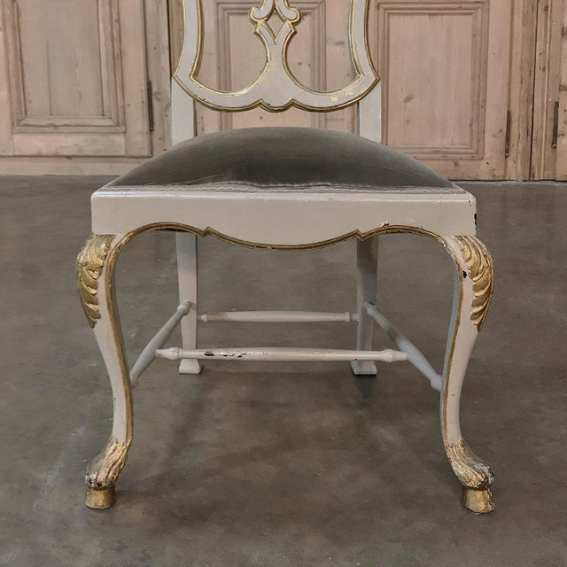 Amazing Set of Eight 19th Century Grey Painted and Gilded Italian Dining Chairs feature superb Baroque styling with a...