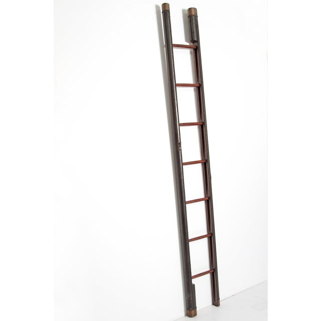 Interesting Edwardian period mahogany folding ladder with seven (7) rungs. Original rounded, leather covered wood with...