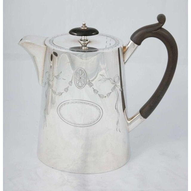 Silver plated three piece coffee set, circa 1890. Milk Jug: W14 x D7 x H9 cm Auxiliar Jug: W18 x D8.3 x H8.5cm Please...