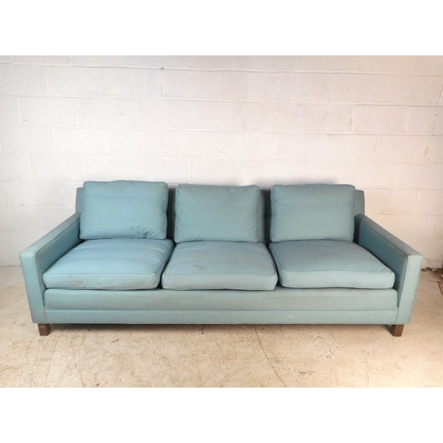 This Mid-Century Modern sofa by Dunbar features a uniformly tufted back and loose cushions. Sturdy walnut legs ensure...