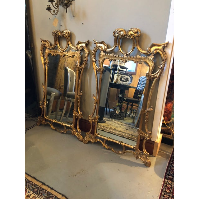 Vintage Late Mid Century Era Pair of Italian Rococo Gilt Mirrors. Made in Italy. Gilt over plaster coats the hand carved...