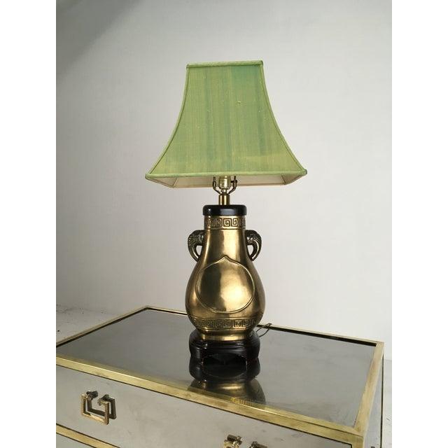 Elegant vintage Paul Hansen lamp with a subtle elephant motif. Elephant trunks form the handles on the sides of the urn-...