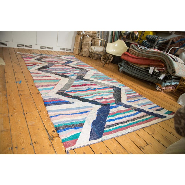 Energized contrasting chevron ivory with light charcoal / black / blue zig zags atop a classic horizontally striated...