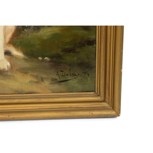 French Victorian gilt framed oil painting of seated black and white terrier (signed DUBOUY,1904)