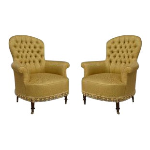 Pair of American Victorian style (20th Cent) green and gilt upholstered tub chairs with tufted back and tassel trim