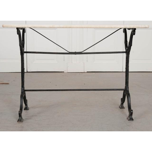 An outstanding French marble top garden table, with iron base, made at the beginning of the 20th century. The white marble...