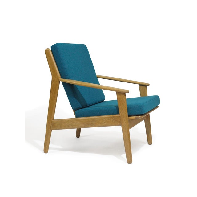 Danish lounge by Poul Vother in solid white oak. Fully restored with new rubber straps, foam, and upholstered in a teal...