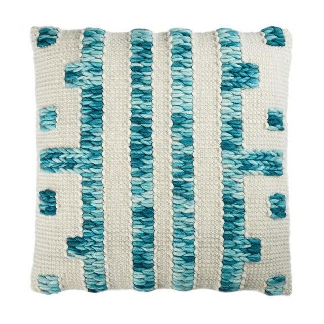 Natural wool pillow with turquoise and cream geometric pattern. Solid natural cotton backing. 95% Feather 5% Down Insert....