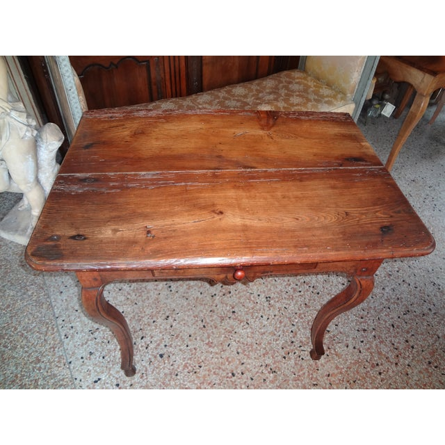 18th century French walnut side table or writing table with cabriole legs ending in a hoof feet. One drawer. Two planks of...