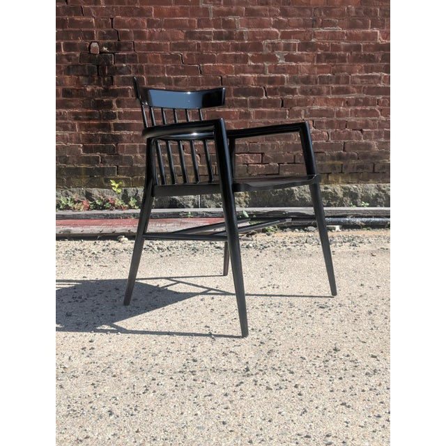 Modernist comb-back windsor chair in black lacquer, designed by Paul McCobb, circa 1955.