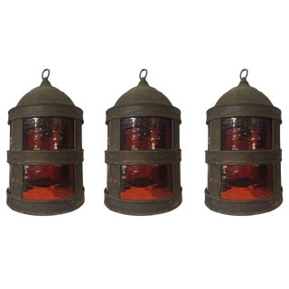 Set of Three Arts & Crafts Tole and Amber Glass Lanterns For Sale
