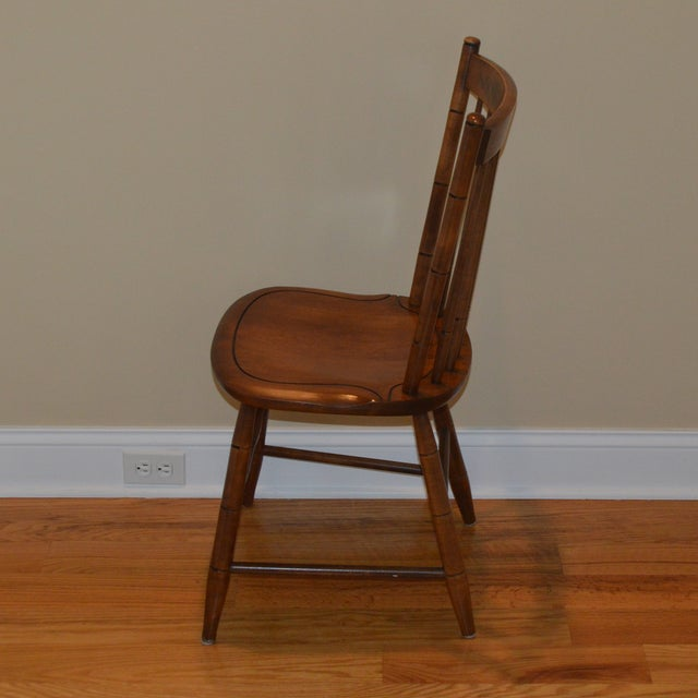 This is a genuine vintage Hitchcock chair. My aunt & uncle were the original owners. This has great stenciling. The stain...