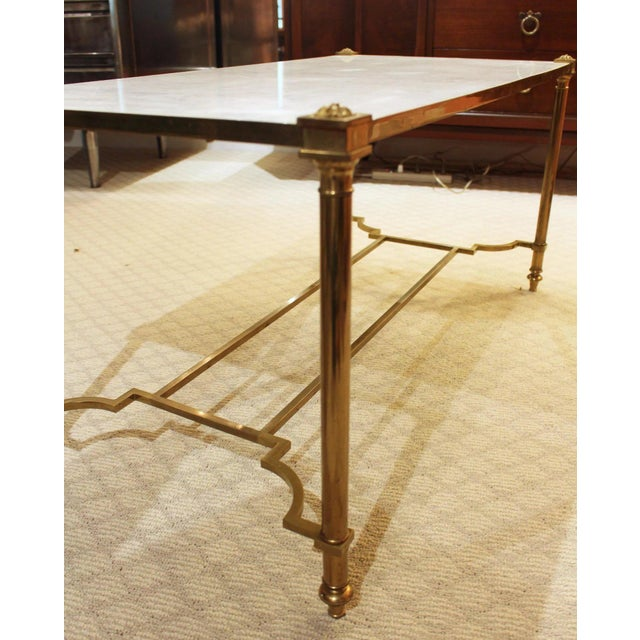 Brass & marble top coffee table, Maison Jansen design, shaped double cross stretcher, rosette caps, turned columnar legs....