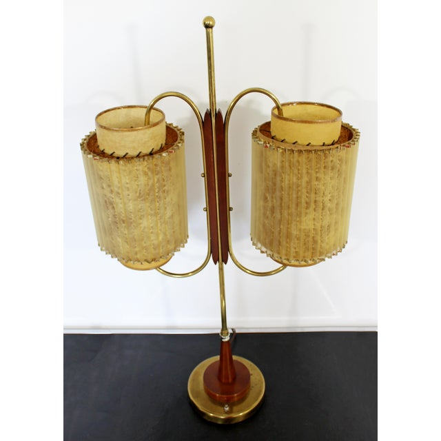 For your consideration is a stunningly sculptural, wood and brass, dual headed table lamp, circa the 190s. In very good...