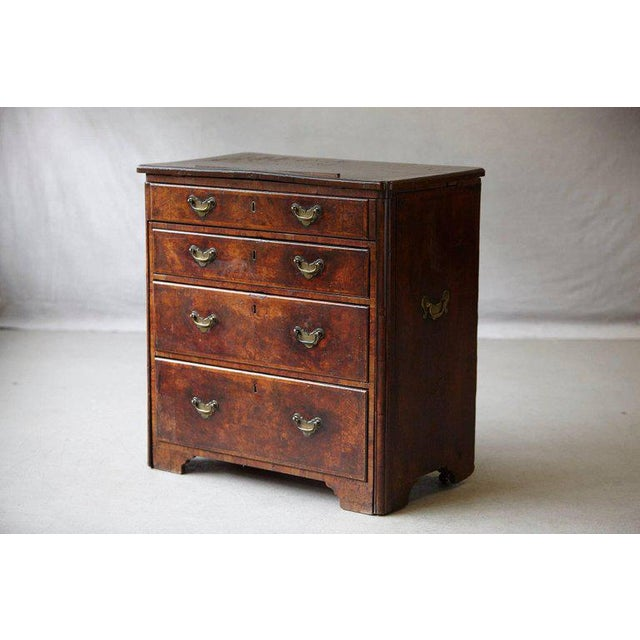 Important and very unique Queen Anne walnut architect's chest with padouk lined drawers with original handles, circa 1710....
