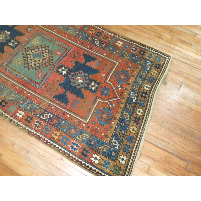 A late 19th century Antique Caucasian Kazak Rug. We love the natural wear on this rug because it shows a real taste of the...