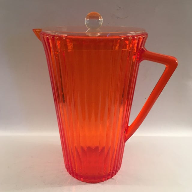 This lucite pitcher was made in Taiwan and is in excellent condition with no scratches. Width measurement is to outer edge...