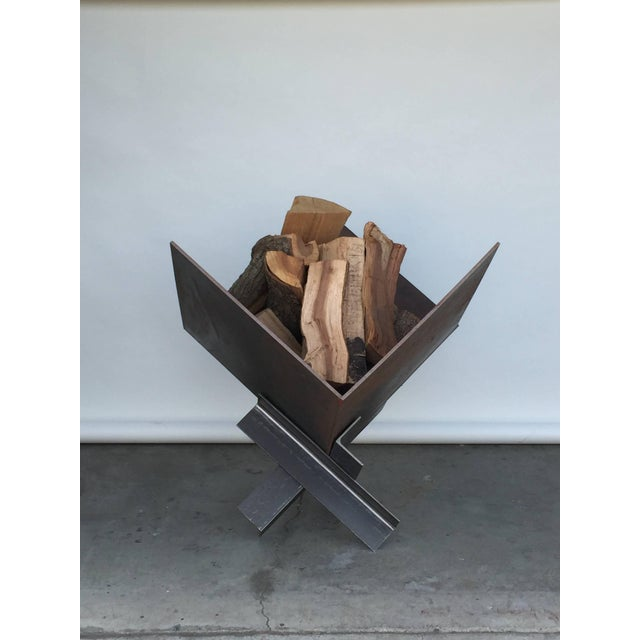 Large patinated steel plate Brutalist fire pit or log holder. For indoor use as a log holder next to a large fireplace or...