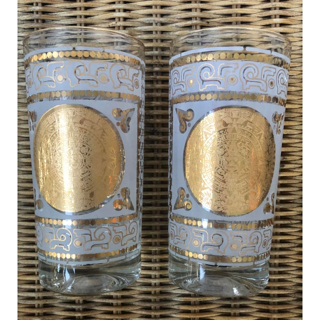 Go for the Mid-Century Modern gold! Aztec or Mayan calendar/Sundial on each or both sides., Each clear glass is...