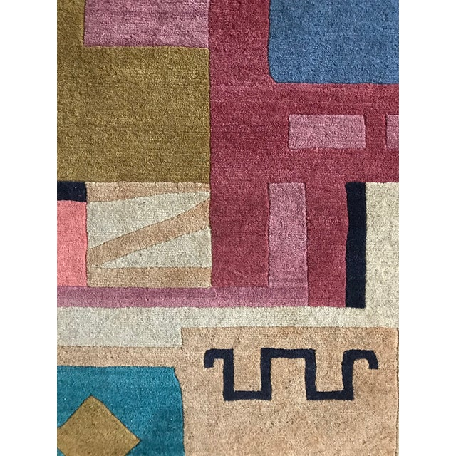 Multi-colored, art-deco influenced geometric rug. All wool with label from Switzerland. C. 1970's.