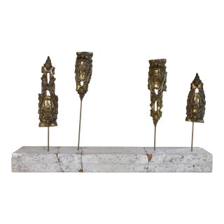 Mantle Piece of Bronze Epaulets Mounted on Travertine For Sale
