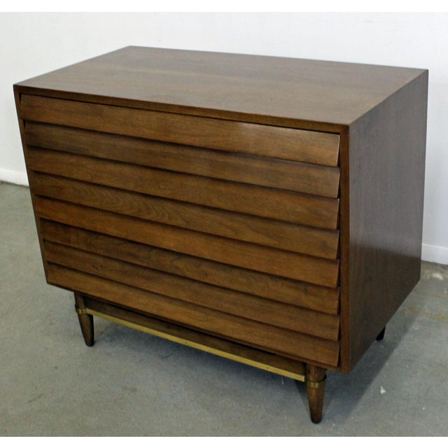 "Offered is a bachelor chest, designed by Merton L. Gershun for American of Martinsville's ""Dania"" line. It is made of..."
