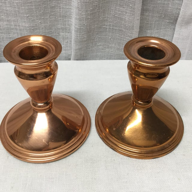 A very nice pair of mid century copper candle holders being offered. Thee feature a simple traditional style and let the...