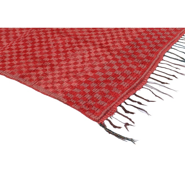 With its primitive charm and checkerboard design, this Berber Moroccan rug synthesizes strikingly well with Bohemian style...