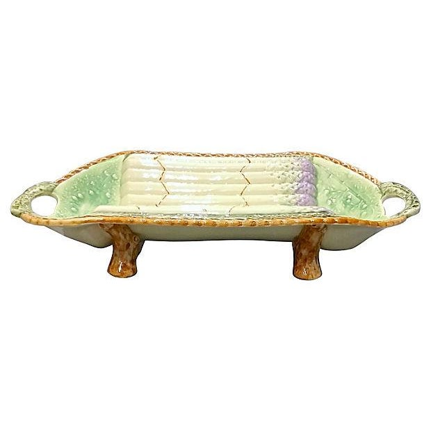 "Antique; 1900-1910, French, hand-painted, majolica, asparagus, serving platter with handles. Marked ""317"" on the underside."