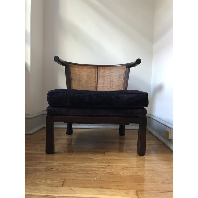 Wonderful petite Asian slipper chair in the style of James Mont. Features a dark wood frame offset with woven rattan back...