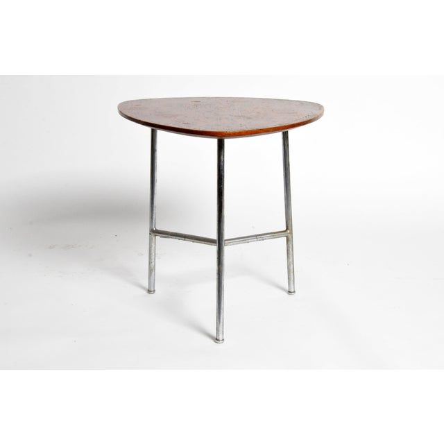 This table is from Budapest, Hungary and is made from wood and metal, circa 1930.