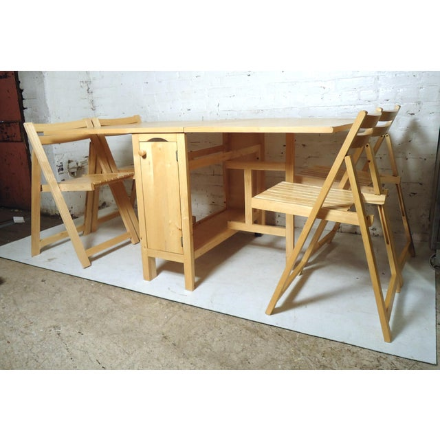 Vintage dining set and four folding chairs. The chairs stow away inside the table perfectly. Please confirm item location...
