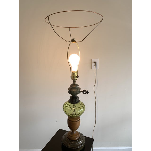 Vintage Hepplewhite Carved Wood Urn, Cast Metal, and Green Depression Glass Lamp With Burlap Shade For Sale - Image 4 of 7