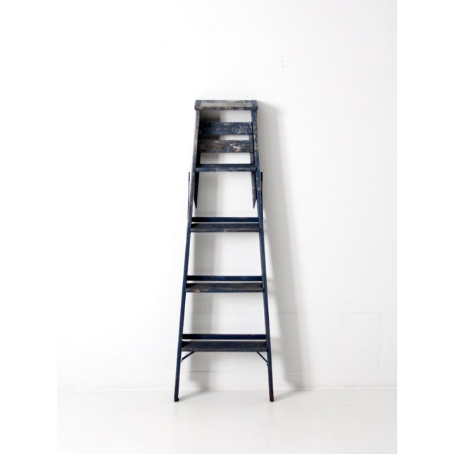 This is a vintage wooden ladder. Hang textiles and towels, or use as shelf, this old painter's ladder has great character...