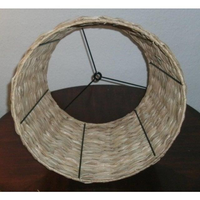 """Slightly tapered woven rattan 9.5"""" height lamp shade. Slightly tapered the top is about 11"""" and the bottom is 14"""" around...."""