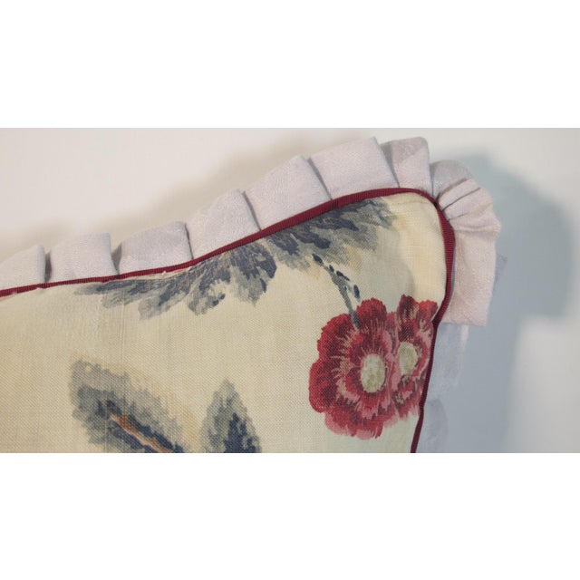 A pillow made from a circa 1920's English Printed Linen, backed and edged with hand dyed linen Damask. A down insert is...
