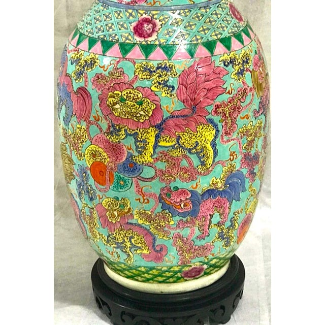 Exquisite Chinese Famille rose foo dog motif vase, now as a Lamp Profusely decorated with numerous foo dogs and lions in a...