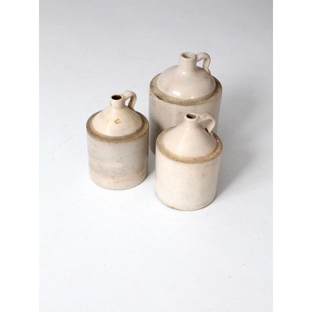 Ceramic Antique Stoneware Crock Jugs - Set of 3 For Sale - Image 7 of 8