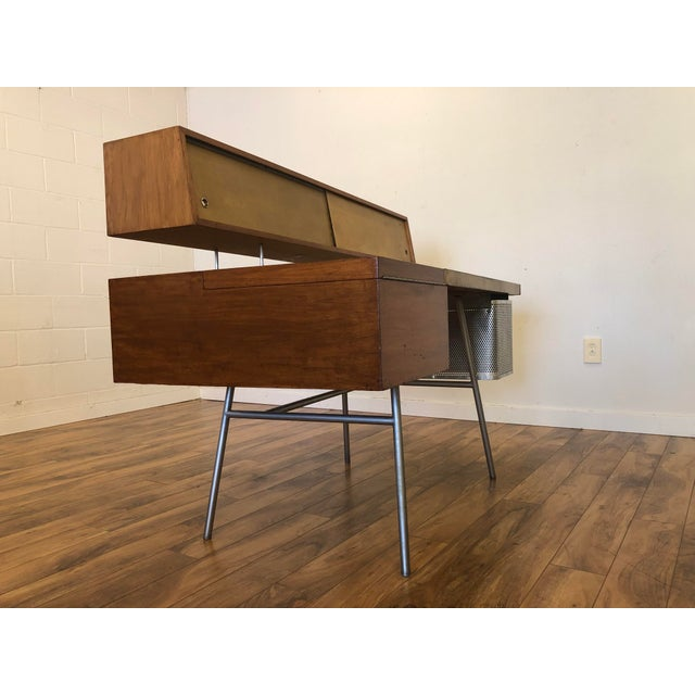 George Nelson for Herman Miller desk number 4658, designed in the mid to late 1940s. This striking desk is constructed of...