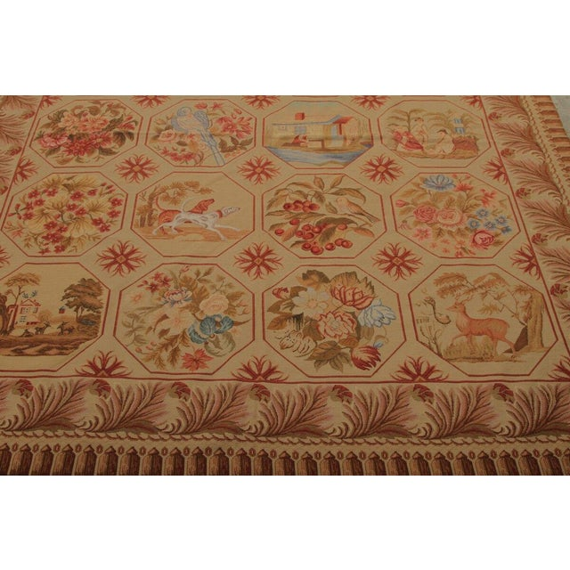 This needlepoint rug features a floral design with a story, a true collector's item. The piece was made in the mid 20th...
