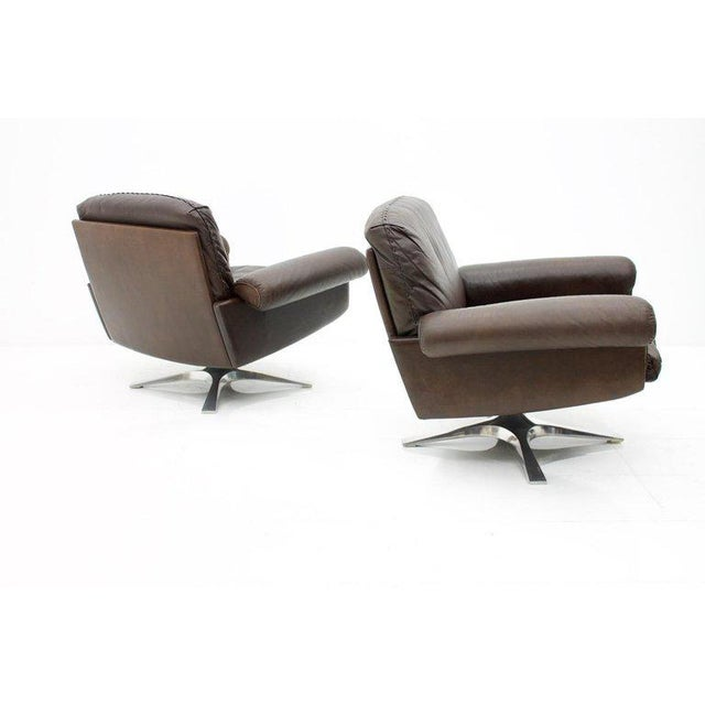 Pair of leather lounge chairs by DE SEDE Switzerland model DS 31, designed in 1967. Chocolate brown leather with beautiful...