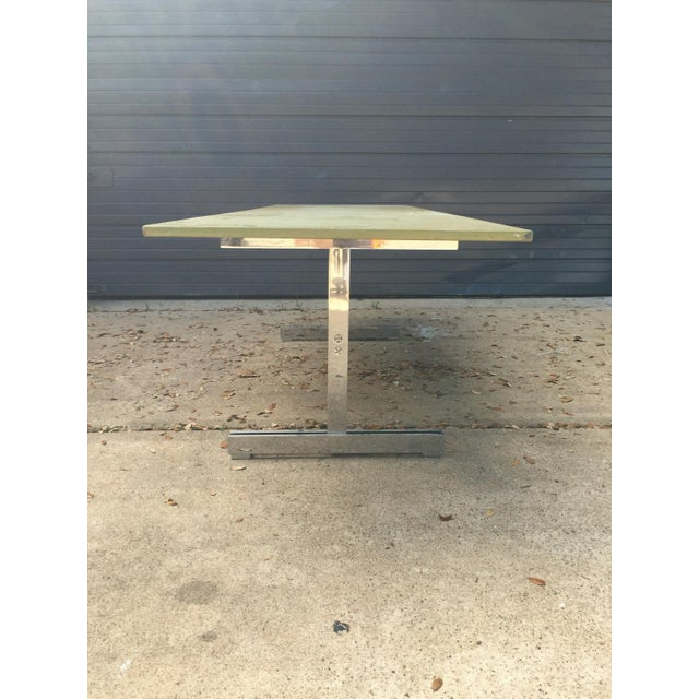 Large coffee or console table with green painting wood top and stainless steel base attributed to John Vesey Listed...
