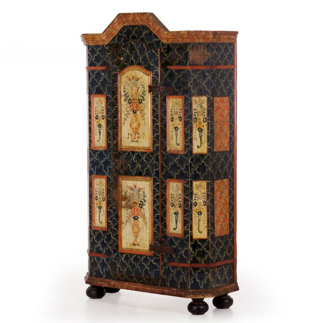 The faceted angular body of this armoire works to relieve the weight of the form, overall being a rather unusual form for...