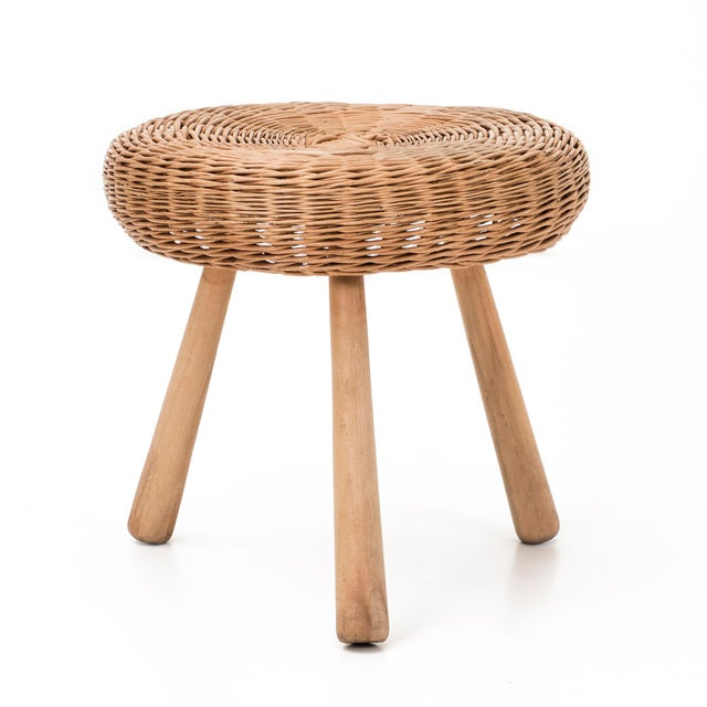 Stool with rattan top and solid walnut legs.