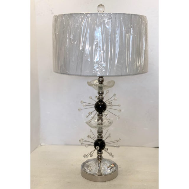 Stunning modern lamp designed by Powell Accessories' artist, Brian Powell, is a one-of-a-kind piece. Using found parts, we...